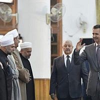President Bashar Assad greets religious leaders at a mosque in Damascus in a picture posted to social media on December 12, 2016. (Instagram/Syrian Presidency)