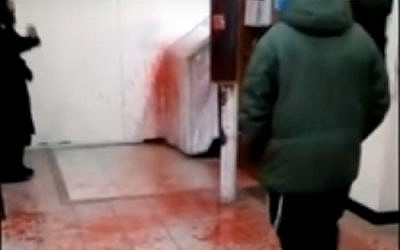 Blood-like paint splattered at the grave-site of Rabbi Nachman of Bratslav in Uman, Ukraine, December 21, 2016. (screen capture: YouTube/YWN)