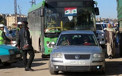 A bus is seen in the embattled city of Aleppo during an evacuation operation of rebel fighters and their families from rebel-held areas on December 15, 2016.   / AFP PHOTO / STRINGER