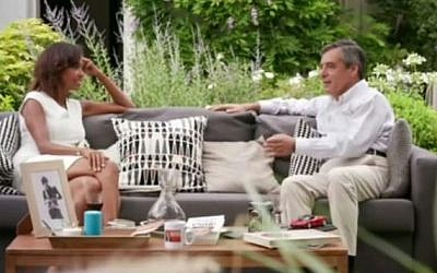 French right-wing presidential candidate Francois Fillon, right, talks with television presenter Karine Le Marchand during an interview for the 'Ambition Intime' (Intimate Ambition) show, broadcast on November 6, 2016. (screen capture: Geekmag/YouTube)
