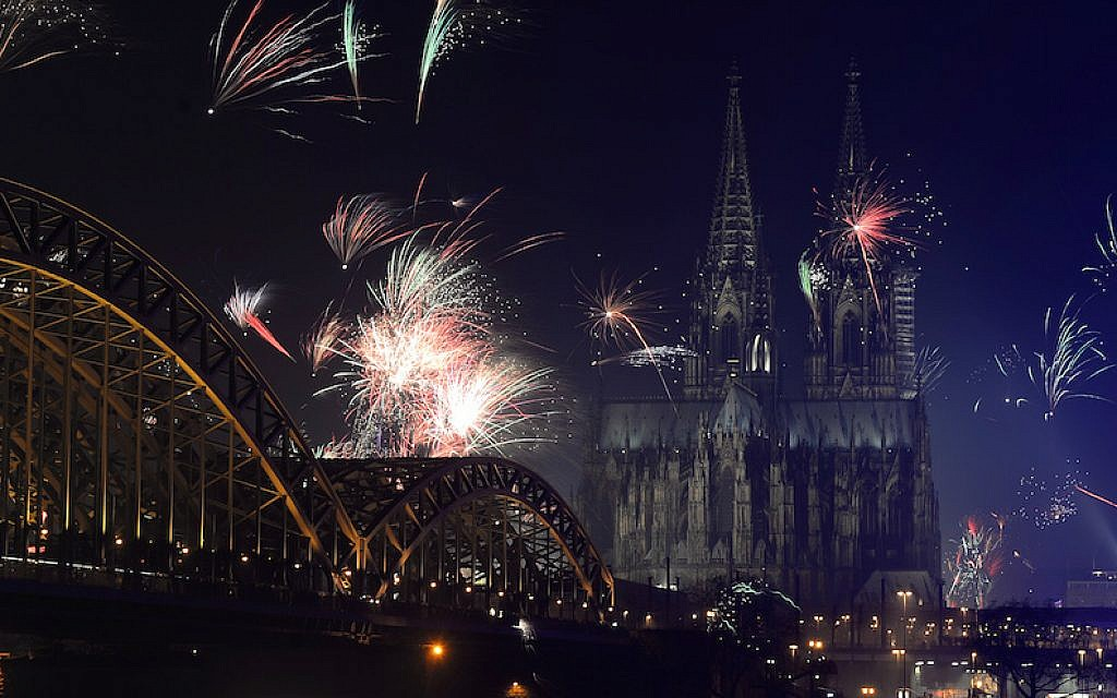 Fireworks exploding over the Rhine River during a New Year's party in Cologne, Germany, January 1, 2014. (Patrik Stollarz/AFP/Getty Images)