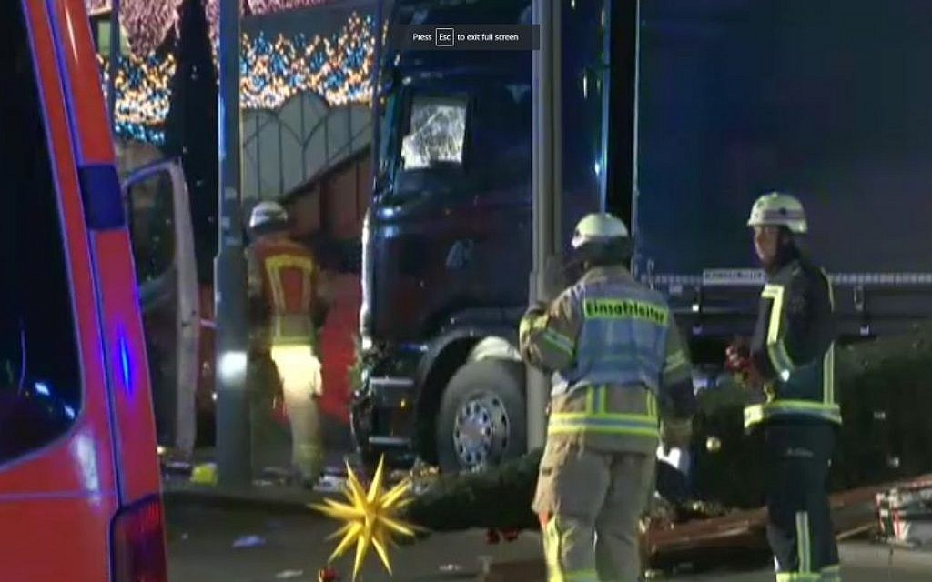 Firefighters around a truck after in crashed into a Berlin Christmas market on December 19, 2016. (screen capture: Fox News)