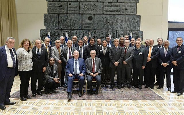 President of Israel Reuven Rivlin (seated, left) and President of the Hebrew University Prof. Menahem Ben-Sasson (seated, right), meet with rectors from universities in Latin America. (Mark Naiman/GPO: Courtesy of Hebrew University)