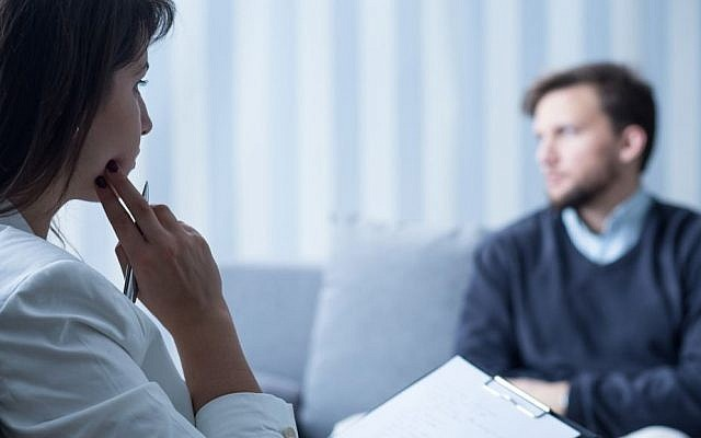 Illustrative photo of a psychologist talking to a patient (KatarzynaBialasiewicz/Getty Images)