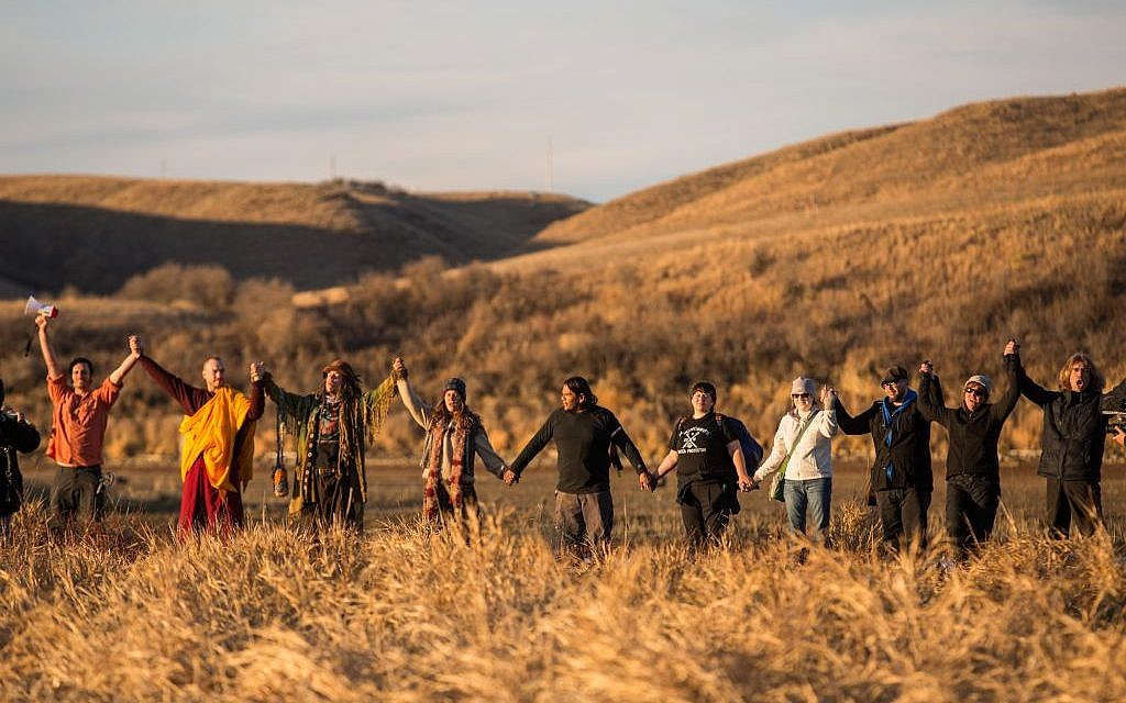 Standing Rock, North Dakota, November 26, 2016: Water Protectors gathered for a prayer circle as the sun set at the base of Turtle Island. (Getty images)