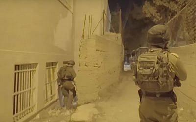 IDF soldiers carry out an arrest raid of four Palestinian teens suspected of carrying out shooting attacks on an army post outside the Ofra settlement in the West Bank. (Screen capture: IDF Spokesperson's Unit)