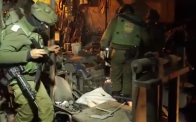 IDF soldiers during a raid of an illegal gun workshop in the West Bank city of Hebron on Monday, December 19, 2016. (Screen capture: IDF Facebook)
