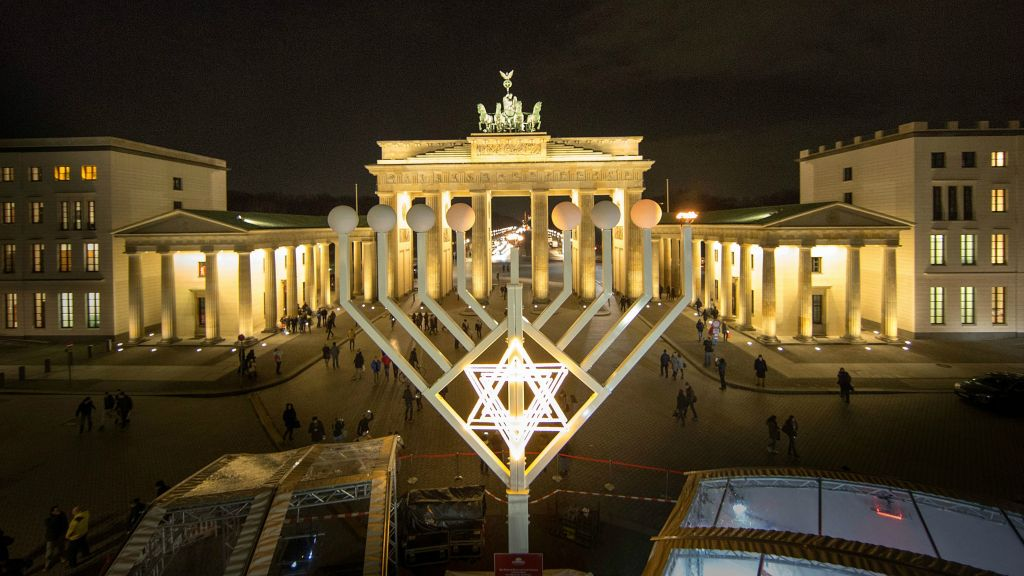 A menorah in front of the Brandenburg Gate in Berlin, December 16, 2014. (Carsten Koall/Getty Images/via JTA)