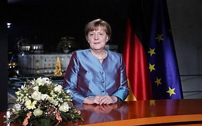 German Chancellor Angela Merkel poses for a photograph after the recording of her annual New Year's speech at the Chancellery in Berlin on December 30, 2016 (AFP photo/POOL/ Markus Schreiber)