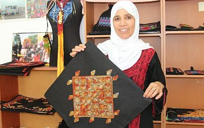 Na'ama Elsa'ana in her shop in Lakiya. Elsa'ana helped found the first Bedouin women's organization in the Negev, found the Association for the Improvement of Women's Status, Lakiya. (Shmuel Bar-Am)