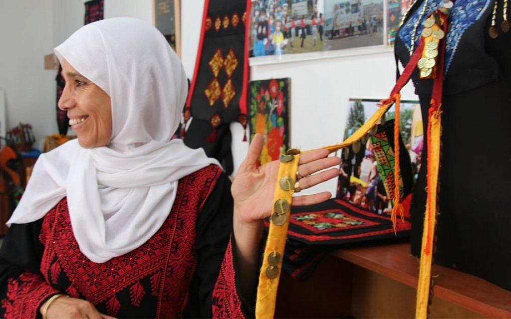 Na'ama Elsa'ana in her shop in Lakiya. Her organization, the Association for the Improvement of Women's Status, Lakiya, helps employ nearly 200 women. (Shmuel Bar-Am)