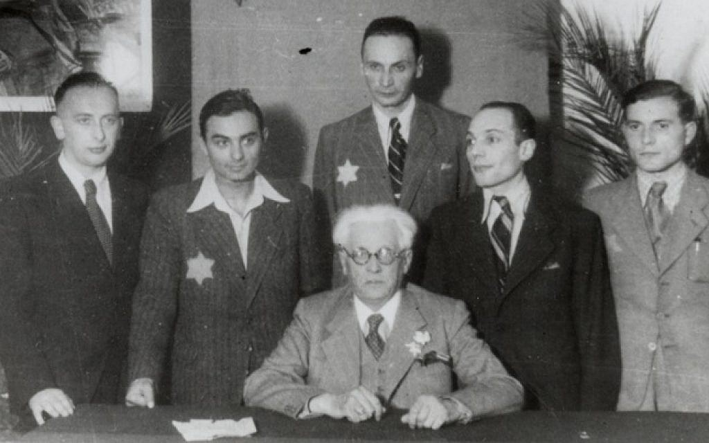 Mordechai Chaim Rumkowski and other officials pose for a group portrait in the Jewish Council's headquarters, Lodz Ghetto, January 1941 (US Holocaust Memorial Museum, courtesy of Judith M. Shaar)