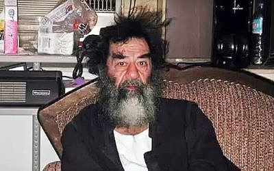 Former Iraqi strongman Saddam Hussein, shortly after his capture in 2003, in a screenshot from a YouTube video uploaded December 17, 2016.