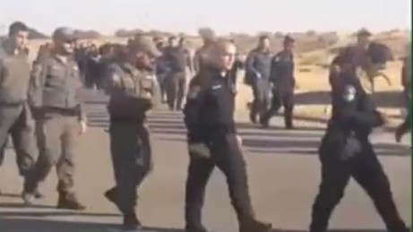 Soldiers and Border Police troops participate in a training exercize at the Tze'elim IDF base in southern Israel ahead of the High Court-mandated ruling to evacuate the West Bank outpost of Amona on December 25, 2016. (Screenshot/Channel 2)