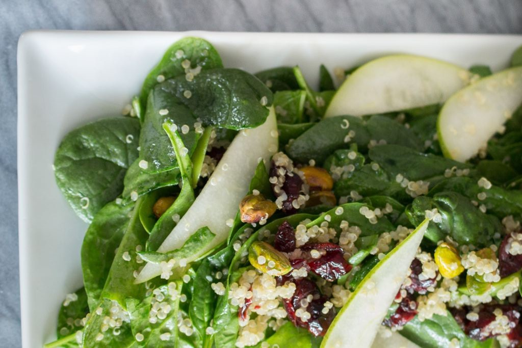 Spinach salad with quinoa, toasted pistachios and cranberries (Megan Wolf/via JTA)