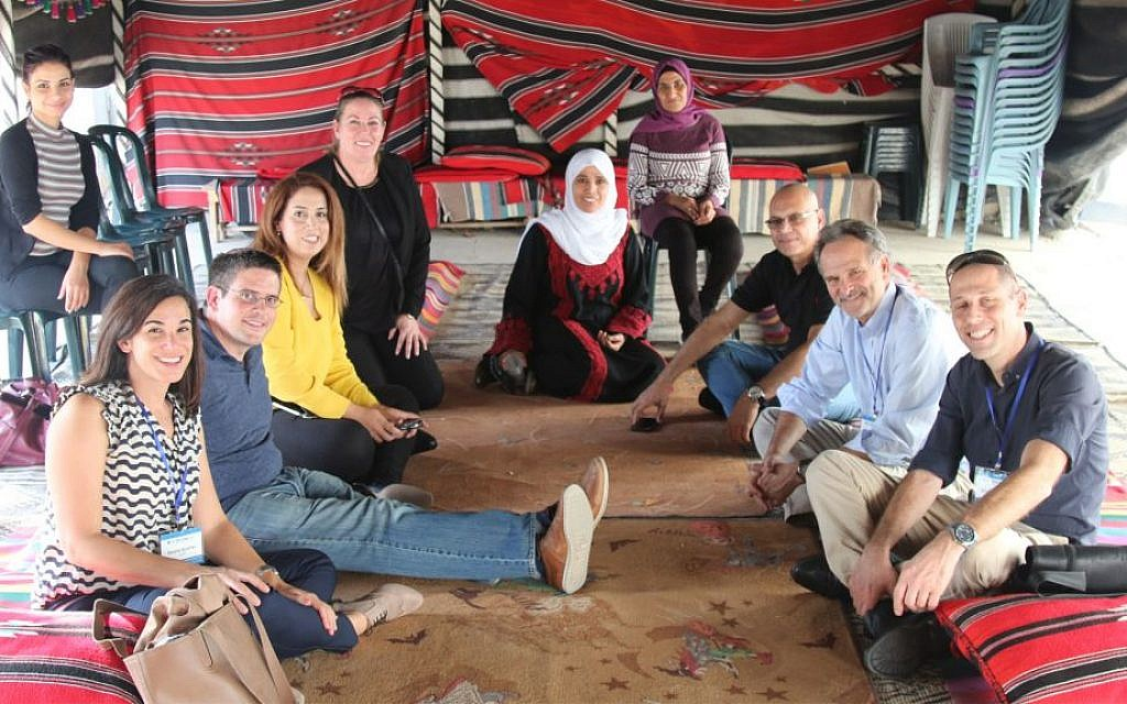 Guests in Desert Embroidery's visitors' center. The group educates tourists on Bedouin traditions, the status of Bedouin women, and the meaning behind different types of embroidery. (Shmuel Bar-Am)