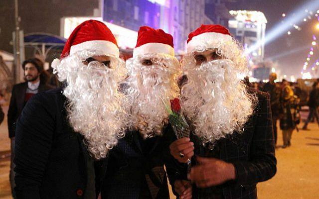 Iraqis dressed as Santa Claus gather at al-Mansour Square during Christmas and New Year's Eve celebrations in the capital Baghdad on December 31, 2016. (Sabah Arar/AFP)