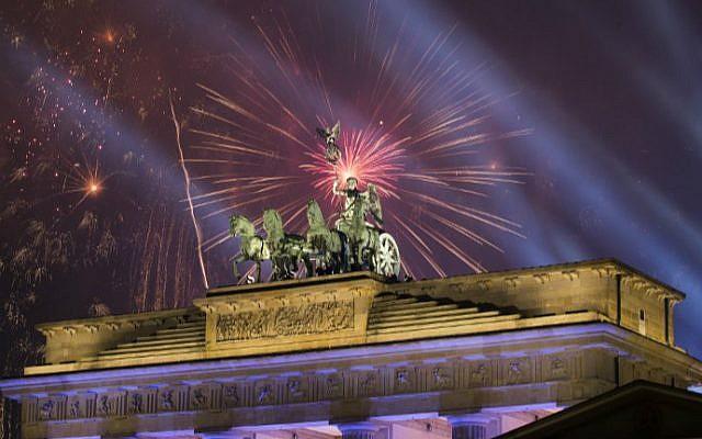Fireworks explode behind the quadriga of Berlin's landmark Brandenburg Gate to usher in the New Year on January 1, 2017. (Odd Andersen/AFP)