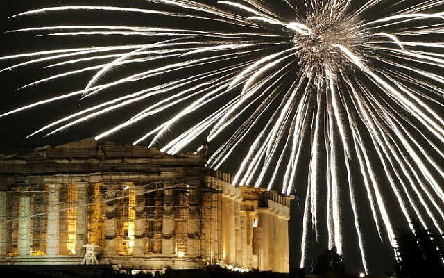 Fireworks explode above the ancient Parthenon temple atop the Acropolis hill during New Year's celebrations in Athens on January 1, 2017. (Angelos Tzortzinis/AFP)