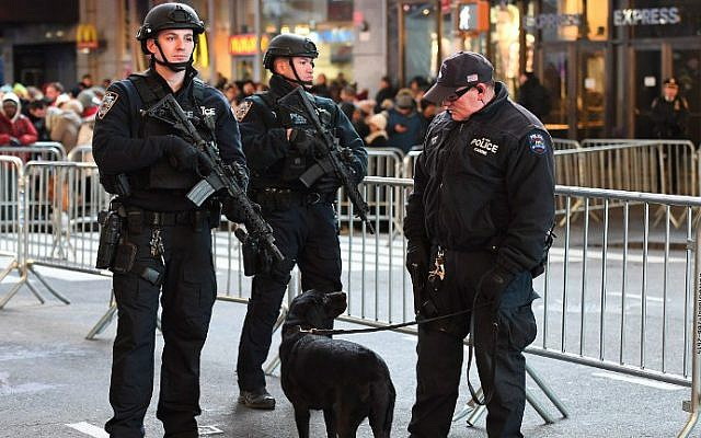 New York City police officers stand guard in Times Square on December 31, 2016. (Angela Weiss/AFP)