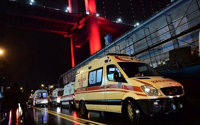 Ambulances are seen at the site of an armed attack January 1, 2017 in Istanbul, Turkey. (AFP PHOTO / YASIN AKGUL)