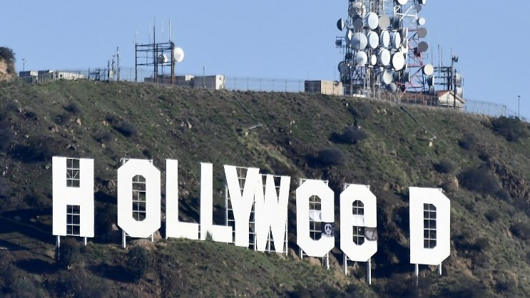 The famous Hollywood sign reads 'Hollyweed' after it was vandalized,  January 1,