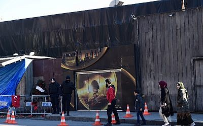 One day after a gunman killed 39 people, including many foreigners, in a rampage at the upmarket Reina nightclub where revellers were celebrating the New Year people walk by the venue, in Istanbul, on January 2, 2017. (AFP/YASIN AKGUL)
