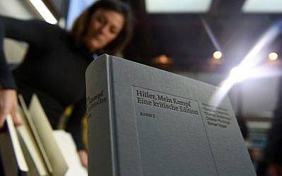 "A copy of an annotated version of Adolf Hitler's book ""Mein Kampf"" prior to a press conference for its presentation in Munich, southern Germany, on January 8, 2016. ( AFP PHOTO / Christof STACHE)"