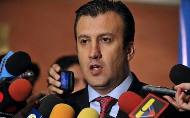 Then-Interior and Justice Minister Tareck El Aissami talking to the press in Caracas on November 10, 2011. (AFP Photo/Leo Ramirez)