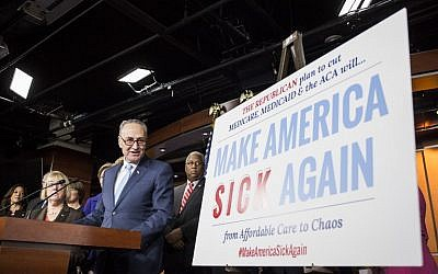 US Senate Minority Leader Chuck Schumer (D-NY) speaking during a press conference discussing Republican attempts to dismantle Medicare, Medicaid, and The Affordable Care Act on Capitol Hill in Washington, DC, January 4, 2017 (AFP PHOTO/ZACH GIBSON)