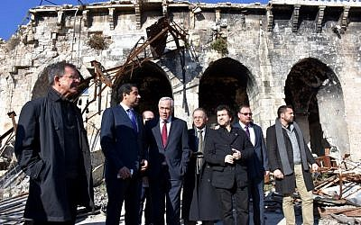 French MPs Thierry Mariani (L) and Nicolas Dhuicq (3rd-R) visit the ancient Umayyad mosque in the old city of Aleppo on January 6, 2017. (AFP PHOTO / George OURFALIAN)