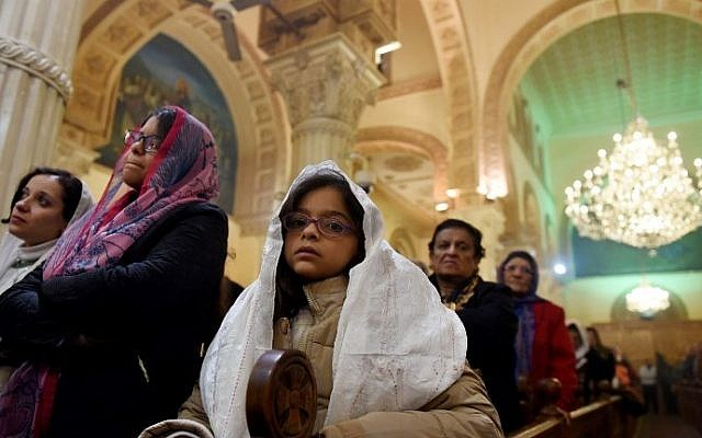 Coptic Orthodox Christians attend a Christmas eve mass at Virgin Mary Church in Road El Farag district, in Cairo, Egypt on January 6, 2017. (AFP PHOTO / MOHAMED EL-SHAHED)