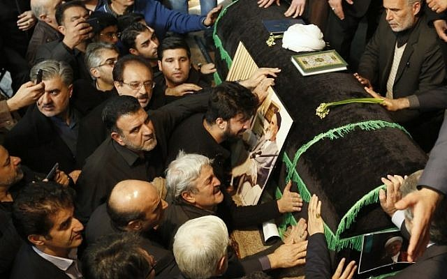 Mourners gather around the coffin of former Iranian president Akbar Hashemi Rafsanjani during a mourning ceremony at the Jamaran mosque in Tehran, on January 9, 2017. (AFP PHOTO / ATTA KENARE)