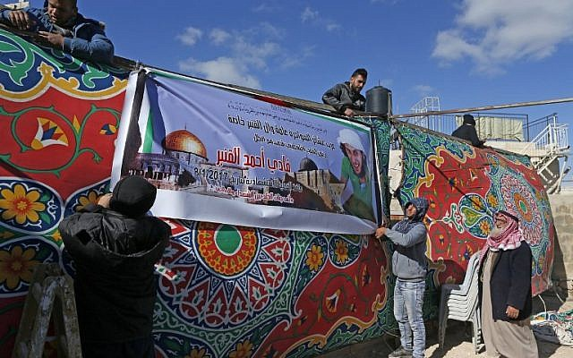 Palestinians put up a memorial tent and poster of attacker Fadi Qunbar at his family home in the East Jerusalem neighborhood of Jabal Mukaber on January 9, 2017. (AFP/AHMAD GHARABLI)