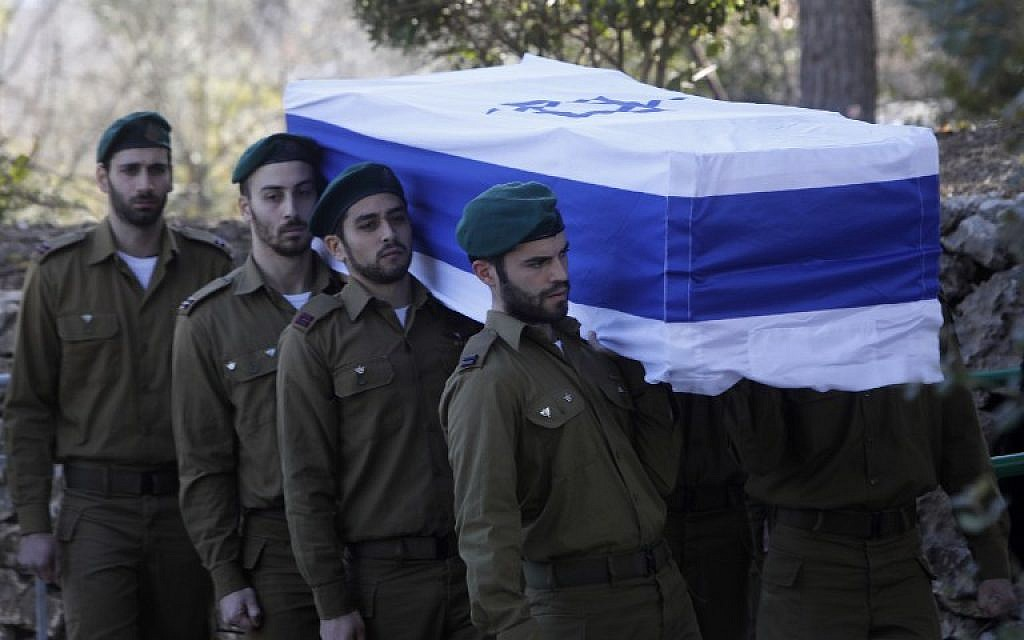 Members of the Israeli security forces carry the coffin of their comrade Lt. Shir Hajaj, 22, during her funeral at the military cemetery on Mount Herzl in Jerusalem on January 9, 2016, a day after she was killed by a Palestinian terrorist when he rammed his vehicle into a group of Israeli soldiers. (Menahem Kahana/AFP)