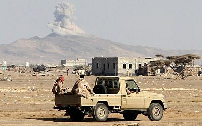 Illustrative: Smoke billows in the distance as Yemeni pro-government forces patrol during clashes against Shiite rebels in Yemen's western Dhubab district, about 30 kms (20 miles) north of the strategic Bab al-Mandab Strait, January 9, 2017. (AFP/Saleh Al-Obeidi)