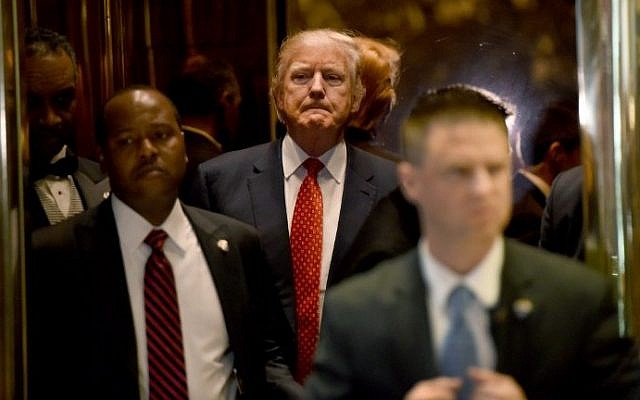 President-elect Donald Trump arrives from the elevator at Trump Tower January 9, 2017 in New York. (AFP Photo/Timothy A. Clary)
