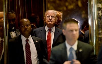 President-elect Donald Trump arrives gets off the elevator at Trump Tower January 9, 2017 in New York (AFP PHOTO / TIMOTHY A. CLARY)