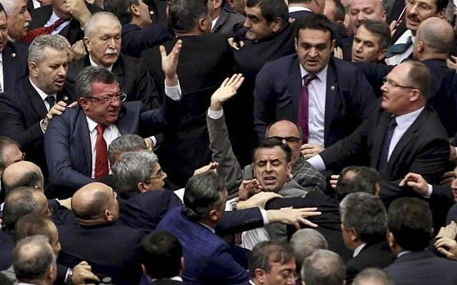 Ruling Justice and Development Party and main opposition Republican People's Party lawmakers scuffle at the parliament in Ankara during deliberations over a controversial 18-article bill to change the constitution to create an executive presidency January 11, 2017. (AFP Photo)