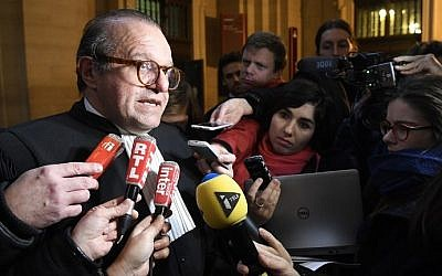 Herve Temime (L), the lawyer of Franco-American art-dealer Guy Wildenstein speaks to journalists on January 12, 2017 at the Paris court house, after the presiding judge cleared the art-dealer of hiding millions of euros in paintings and properties from the taxman. (AFP Photo/Lionel Bonaventure)