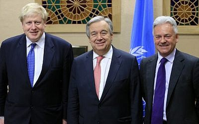 British Foreign Secretary Boris Johnson (L) poses with United Nations Secretary General Antonio Guterres (C) and British Minister of State for Foreign Affairs Alan Duncan (R) after a meeting ahead of the Conference on Cyprus at the European headquarters of the United Nations in Geneva, Switzerland, on January 12, 2017.  (AFP PHOTO / POOL / PIERRE ALBOUY)