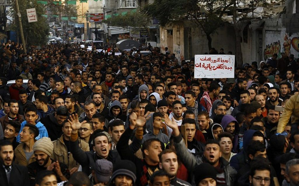 Palestinians chant slogans during a protest against the ongoing electricity crisis in Jabalia refugee camp in the northern Gaza Strip, January 12, 2017. (AFP/MOHAMMED ABED)