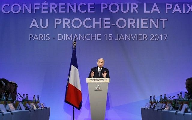 French Minister of Foreign Affairs Jean-Marc Ayrault addresses delegates at the opening of the Mideast peace conference in Paris on January 15, 2017. (AFP PHOTO / Thomas SAMSON)