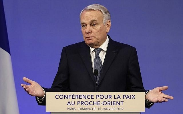French Minister of Foreign Affairs Jean-Marc Ayrault addresses delegates at the opening of the Mideast peace conference in Paris on January 15, 2017. (AFP PHOTO / POOL / Thomas SAMSON)