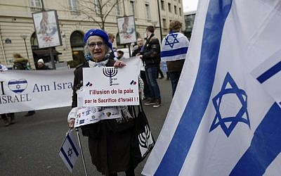"A woman holds a sign reading ""The illusion of peace by the sacrifice of Israel"" during a protest rally  against the Paris Middle East peace conference, January 15, 2017. (AFP/Pierre CONSTANT)"