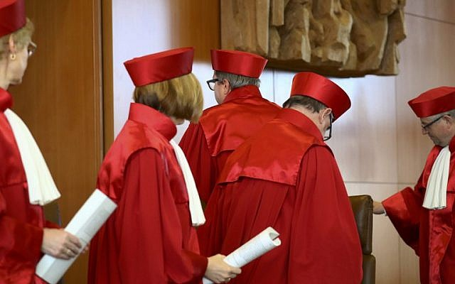 The President of Germany's Constitutional Court Andreas Vosskuhle and his judges leave the room after proclaiming their verdict on a possible ban of Germany's right-extremist NPD party at the Federal Constitutional Court in Karlsruhe, southwestern Germany, on January 17, 2017. (AFP/POOL/KAI PFAFFENBACH)