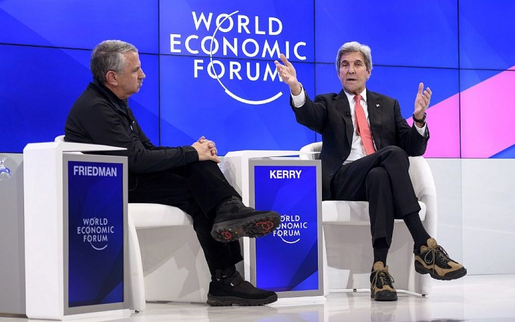 Outgoing US Secretary of State John Kerry (R) gestures as he speaks on the opening day of the World Economic Forum, on January 17, 2017, in Davos. The global elite begin a week of earnest debate and Alpine partying in the Swiss ski resort of Davos on January 17, 2017 in a week bookended by two presidential speeches of historic import. (AFP PHOTO / FABRICE COFFRINI)