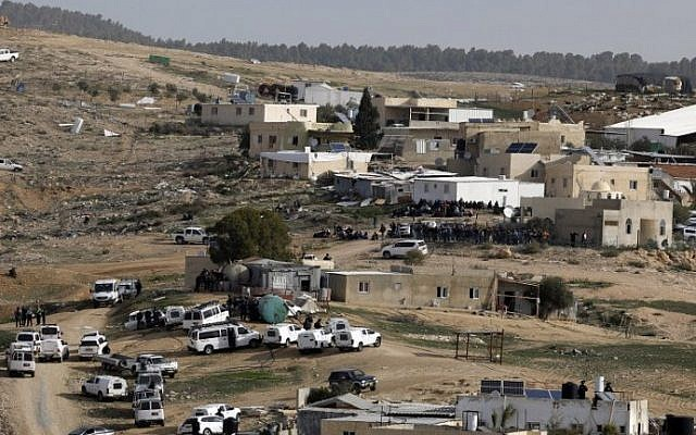Israeli police (foreground) gather in the unreocgnized Bedouin village of Umm al-Hiran in the Negev desert. (AFP Photo/Menahem Kahana)