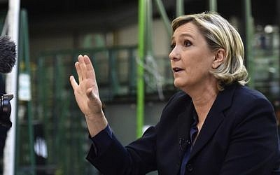 France's Front National (FN) far-right party's President and presidential candidate for the 2017 election Marine Le Pen gestures while speaking to a journalist at the Fermap manufacturing factory in Forbach, eastern France, on January 18, 2017. (AFP PHOTO / PATRICK HERTZOG)