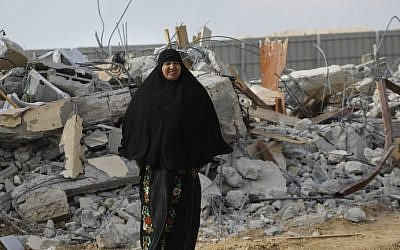 A Bedouin woman cries following the destruction of houses on January 18, 2017 in the village of Umm al-Hiran. (AFP/Menahem Kahana)